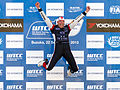 Tom Coronel jumping on the podium 2013 WTCC Race of Japan.jpg
