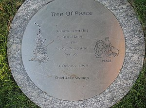 Great Osage Trail - Commemorative marker near base of an oak tree planted on the property of the Independence Temple in 1999, a few dozen yards south of a stretch of The Great Osage Trail which today is known as Lexington Street/Avenue in Independence, Missouri.
