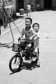 Two little boys on bike in China.jpg