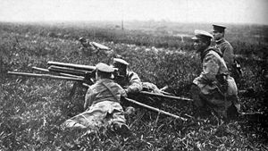 Type 11 37 mm infantry gun - A infantry gun unit from the same Japanese book. The two main gunners are operating the gun, the first reserve gunner kneels immediately behind them. The squad leader is kneeling off slightly to one side, and a second reserve gunner is lying off to one side.