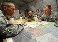 U.S. Army Lt. Col. David Doyle, left, briefs Lt. Gen. Ken Keen, the commanding general of Joint Task Force - Haiti, on internally displaced persons camps in his area of responsibility in Port-au-Prince, Haiti 100316-N-HX866-002.jpg