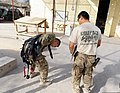 U.S. Army Spc. Wilson Berlin, left, a member of the Farah Provincial Reconstruction Team (PRT) security force, prepares to depart Forward Operating Base Farah for a mission to Farah city, Farah province 120829-N-II659-282.jpg