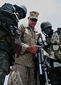 U.S. Marine Corps Lance Cpl. Frederick P. Shearon, center, a rifleman with the 3rd Battalion, 25th Marine Regiment, shows features of his weapon system, an M16A4 rifle with an attached M203 grenade launcher, to 120710-M-XI134-002.jpg