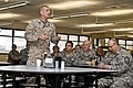 U.S. Marine Corps Sgt. Maj. Bryan B. Battaglia, the senior enlisted adviser to the chairman of the Joint Chiefs of Staff, speaks to U.S. Soldiers and Airmen with the Illinois National Guard at the 182nd Airlift 130406-Z-EU280-055.jpg