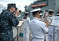 U.S. Navy Mass Communication Specialist 1st Class Patrick Dille takes a photo of the Royal Thai Navy band during the arrival of the dry cargo ship USNS Washington Chambers (T-AKE 11) in support of Cooperation 130603-N-RG360-126.jpg