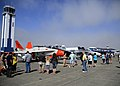 U.S. Service members and civilians walk along the flight line for a look at modern and vintage aircraft on display during the Centennial of Naval Aviation celebration at Naval Air Station Whidbey Island, Wash. 110730-N-ZK021-003.jpg