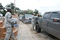 U.S. Soldiers with Bravo Company, 199th Brigade Support Battalion, Louisiana Army National Guard load food, water and ice into a truck in New Orleans Sept 120902-A-SM895-016.jpg