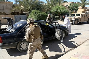 Islamic State of Iraq - US Marines in Ramadi, May 2006, conducting a snap vehicle checkpoint patrol to disrupt insurgent activity
