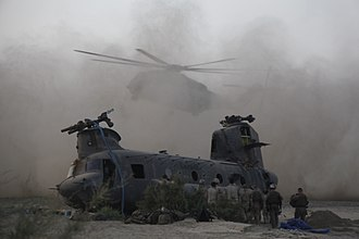 Canada in the War in Afghanistan - A Marine Heavy Helicopter CH-53E Super Stallion lands next to a downed Canadian Forces CH-47 Chinook during a tactical recovery of aircraft and personnel mission in Kandahar Province.