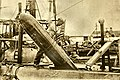 USS Adder loading a Mark 7 torpedo while on Manila Station.jpg