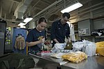 USS Essex Sailors inspect life raft survival equipment 151006-N-BU440-012.jpg