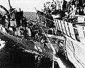 USS Lee Fox (APD-45) after colliding with USS Gilbert Islands (CVE-107), in 1945.jpg