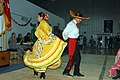 US Army 52966 CAMP LIBERTY, Iraq - Staff Sgt. Alma Selvera (left), of Oklahoma City, Okla., and Sgt. 1st Class Frank Rodriguez, of San Marcos, Texas, perform a traditional Jalisco Mexican dance as part of the group.jpg