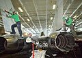 US Navy 020701-N-3986D-001 F-14 maintenance in ship's hangar bay.jpg