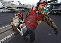 US Navy 030321-N-3235P-501 Aviation Ordnancemen attached to the.jpg