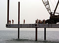 US Navy 030412-N-1050K-040 U.S. Navy Seabees attached to Amphibious Construction Battalions One and Two (ACB-1, ACB-2) prepare to place the next pile in the building of the Elevated Causeway System-Modular (ELCAS-M) structure.jpg