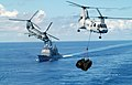 US Navy 030903-N-2009B-105 Two CH-46D Sea Knights transport cargo.jpg