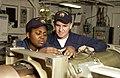 US Navy 040513-N-2101W-018 Sonar Technician 3rd Class Angela Phillips of Annapolis, Md. and Torpedoman's Mate Seaman Michael Leet of Columbus, Ga., band a torpedo.jpg