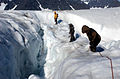 US Navy 040810-N-0331L-002 Chief Aviation Mishap Investigator for the Naval Safety Center, Cdr. Charles Huff and Mountain Guide, Philip Poole cross a crevasse to locate the wreckage of LA-9 a Navy P-2V Neptune aircraft.jpg