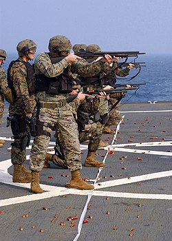 US Navy 041102-N-4649C-001 U.S. Marines assigned to Commander, Seventh Fleet, Fleet Anti-terrorism Security Team (FAST), Third Platoon, familiarize themselves with the M500 shotgun