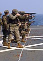 US Navy 041102-N-4649C-001 U.S. Marines assigned to Commander, Seventh Fleet, Fleet Anti-terrorism Security Team (FAST), Third Platoon, familiarize themselves with the M500 shotgun.jpg
