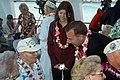 US Navy 041207-N-6775N-031 Senator Jim Reynolds (R-OK) and his daughter speaks with retired Chief Engineman Charles W. Slip Hailslip about his experiences aboard USS Arizona.jpg