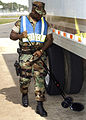 US Navy 051117-N-6644B-005 Culinary Specialist 2nd Class Damion Hart, assigned to Auxiliary Security Force on board Naval Air Jacksonville, Fla., inspects the under carriage of an eighteen wheel rig.jpg