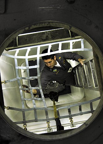 Board of Inspection and Survey - Image: US Navy 060110 N 7981E 014 Lt. Jerry Graven, a Board of Inspection and Survey (INSURV) officer, inspects cargo netting aboard the Nimitz class aircraft carrier USS Abraham Lincoln (CVN 72)