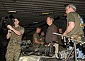 US Navy 060214-N-7217H-016 Cpl. Stephen Bray, assigned to the 13th Marine Expeditionary Unit (13th MEU), BLT Golf Company, explains the purpose of the MK-153 Shoulder Launched Multi Purpose Assault Weapon (SMAW) to Tiger Cruise.jpg