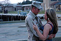 US Navy 060331-N-8907D-083 Equipment Operator 3rd Class Luke Stobbe assigned to Amphibious Construction Battalion Kuwait, is greeted by loved ones on board Naval Amphibious Base Little Creek, Va.jpg
