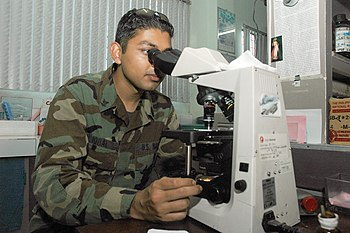 US Navy 060530-N-3931M-042 U.S. Navy Hospital Corpsman 3rd Class Umair Iqbal, examines blood chemistry using a microscope in the medical laboratory at the Zamboanga Medical Center.jpg