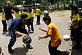US Navy 060621-N-5663H-116 Commanding Officer USCGC Sherman (WHEC 720), Capt. Charles L. Diaz, plays basketball with a Thai student during a community service project at Nongjubtao School.jpg