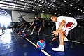 US Navy 070421-N-6326B-065 Sailors participate in a dodge ball tournament, sponsored by Morale, Welfare and Recreation (MWR), in the hangar bay aboard nuclear-powered aircraft carrier USS Nimitz (CVN 68).jpg