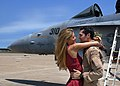 US Navy 070522-N-1082Z-006 Lt. Joshua Keever assigned to the Rampagers of Strike Fighter Squadron (VFA) 83 greets his wife after arriving home.jpg