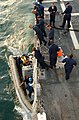 US Navy 071001-N-5459S-050 Sailors assigned to the U.S. Navy guided-missile destroyer USS Bainbridge (DDG 96) man the boat deck to refuel and assist members of the Bainbridge search and rescue team.jpg