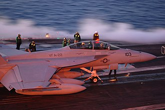 VFA-22 - Image: US Navy 071202 N 3659B 092 The aircrew of an F A 18F Super Hornet, assigned to VFA 22, wait to launch from USS Ronald Reagan (CVN 76)