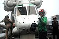 US Navy 080730-N-5384B-084 A landing signal enlisted communicates with a Royal New Zealand Navy SH-2G Sea Sprite aboard the Nimitz-class aircraft carrier USS Abraham Lincoln (CVN 72).jpg