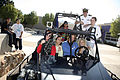 US Navy 080917-N-3271W-011 Lt. Andrew Baldwin, M.D. stands atop the Desert Patrol Vehicle with students from Monzano High School.jpg