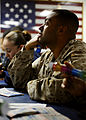 US Navy 090524-N-5345W-177 Pfc. Alonso Alvarado, assigned to the 22nd Marine Expeditionary Unit (22 MEU), waits for the next number to be called while participating in a Morale Welfare ^ Recreation (MWR) sponsored bingo night.jpg