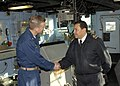 US Navy 090630-N-0924R-019 Cmdr. Daniel Blackburn, commanding officer of the amphibious dock landing ship USS Oak Hill (LSD 51), left, and Navy of the Argentine Republic Lt. Cmdr. Marcelo Paredes shake hands at the end of a tou.jpg