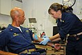 US Navy 090811-N-1831S-172 Lt. Christine Arriola, medical officer aboard amphibious dock landing ship USS Fort McHenry (LSD 43), demonstrates the proper technique for placing a catheter on the arm.jpg