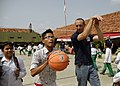 US Navy 090825-N-8539M-201 Engineman 2nd Class Carman Coleman, assigned to the guided-missile destroyer USS Russell (DDG 59), offers an Indonesian boy pointers on his jump shot.jpg