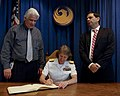 US Navy 100324-N-2389S-072 Rear Adm. Robin Graf, deputy commander of Navy Recruiting Command, signs the official guest ledger Phoenix, Ariz. while visiting Mayor Phil Gordon, right, and Councilman Claude Mattox.jpg