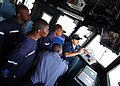 US Navy 100412-N-6138K-395 Ensign Matthew Sweet shows Tanzanian and Togolese Sailors the ship's security camera monitor aboard USS Gunston Hall (LSD 44).jpg