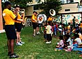 US Navy 100517-N-3446M-202 U.S. 7th Fleet Band ensemble, Orient Express, perform a concert as the children from the Fountain of Life Children's Center dance.jpg