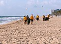 US Navy 110427-N-DD445-002 Sailors assigned to the amphibious assault ship USS Iwo Jima (LHD 7) collect trash off Fort Lauderdale Beach during a Fl.jpg