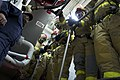 US Navy 110623-N-ZC343-013 Sailors aboard USS Bonhomme Richard (LHD 6) prepare to relieve the primary hose team during a main space fire drill.jpg