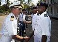 US Navy 110803-N-OV802-085 Capt. Dan Shaffer, left, shakes hands with Maj. Gen. Saidi Shabani Omar during an office call with members of the Tanzan.jpg