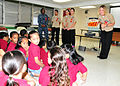 US Navy 111013-N-ET019-825 Sailors assigned to the submarine tender USS Frank Cable (AS 40) tell students from Henry B. Price Elementary School abo.jpg