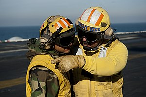 US Navy 111215-N-BT887-012 Lt. Glenn Harrison, a flight deck officer aboard the Nimitz-class aircraft carrier USS John C. Stennis (CVN 74), discuss.jpg